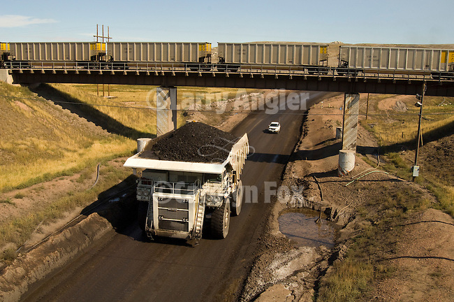 Black Thunder coal mine trucks--Komatsu and Leibherr-- haul coal from the mine to the rail coaling station for shipment to power plants in the Midwest.