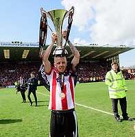 Lincoln City's Terry Hawkridge holds aloft the Vanarama National League trophy<br /> <br /> Photographer Chris Vaughan/CameraSport<br /> <br /> Vanarama National League - Lincoln City v Macclesfield Town - Saturday 22nd April 2017 - Sincil Bank - Lincoln<br /> <br /> World Copyright &copy; 2017 CameraSport. All rights reserved. 43 Linden Ave. Countesthorpe. Leicester. England. LE8 5PG - Tel: +44 (0) 116 277 4147 - admin@camerasport.com - www.camerasport.com