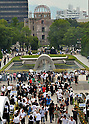 August 6, 2011, Hiroshima, Japan - People offer prayers at the cenotaph during a memorial ceremony at Peace Memorial Park in Hiroshima on Saturday, August 6, 2011. The skeletal A-bomb Dome is in background.....Japan observed the 66th anniversary of the atomic bombing with a moment of silence and the release of doves in a memorial ceremony as the nation struggles to put a different kind of nuclear disaster under control at the crippled power plant in northeast. The worlds first A-bomb destroyed most of this western industrial city, killing as many as 140,000 people in the summer of 1945. A second atomic bombing Aug. 9 that year in Nagasaki killed tens of thousands more and prompted the Japanese to surrender. (Photo by Natsuki Sakai/AFLO [3615] -mis-