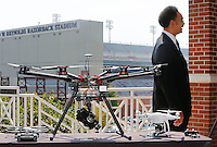 NWA Democrat-Gazette/DAVID GOTTSCHALK  Captain Gary Crain (right), with the University of Arkansas Police Department, discussesthe prohibition of Unmanned Aircraft Systems, commonly referred to as unmanned aerial vehicles or drones, on University property Monday, August 31, 2015 on the terrace of Janelle Y. Hembree Aumni House on the campus in Fayetteville.