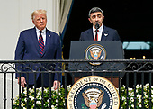 """Sheikh Abdullah bin Zayed bin Sultan Al Nahyan, Minister of Foreign Affairs and International Cooperation of the United Arab Emirates makes remarks during the signing ceremony of the """"Abraham Accords"""" on the South Lawn of the White House in Washington, DC on Tuesday, September 15, 2020.  Looking on at left is United States President Donald J. Trump.<br /> Credit: Chris Kleponis / Pool via CNP"""