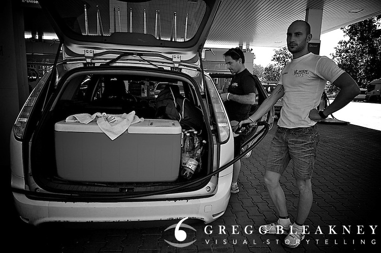 En route to the feed zone, Marco (soigneur) is responsible for making sure that the team cars are gased-up.""