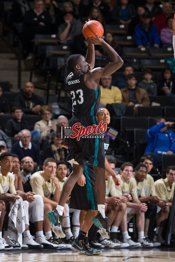Badou Diagne (23) of the Coastal Carolina Chanticleers takes a jump shot during first half action against the Wake Forest Demon Deacons at the LJVM Coliseum on December 18, 2015 in Winston-Salem, North Carolina.  The Demon Deacons defeated the Chanticleers 83-77.  (Brian Westerholt/Sports On Film)