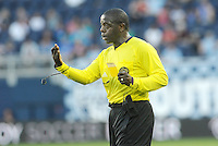 Referee Abiodun Okilaja gives out a yellow card... Sporting KC defeated FC Dallas 2-1 at LIVESTRONG Sporting Park, Kansas City, Kansas.
