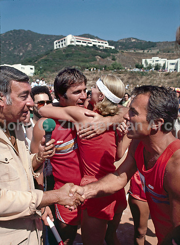 Battle of the Network Stars Host Howard Cosell (Left) congratulates NBC team captain Robert Conrad (R). Gil Gerard hugs teammate in background. Pepperdine University, Pepperdine California, November 1979. Photo by John G. Zimmerman.