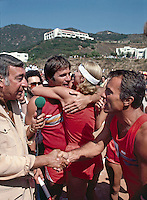 Battle of the Network Stars Host Howard Cosell (Left) congratulates NBC team captain Robert Conrad (R). Gil Gerard hugs teammate in background. Pepperdine University, Pepperdine California, November 1979. Photo by John G. Zimmerman.
