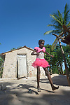 Iznaida Dalmas, 7, plays hopscotch in front of her familiy's new house on the Haitian island of La Gonave. Service Chr&eacute;tien d&rsquo;Ha&iuml;ti is working with survivors of Hurricane Matthew, which struck the region in 2016, to rebuild damaged housing. A member of the ACT Alliance, SCH also supports agriculture on the island by providing tools, seeds, and technical support and training for farmers.<br /> <br /> Parental consent obtained.