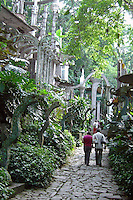 Visitors walking down the Avenue of the Serpents at Las Pozas, Xilitla, Mexico