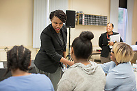 Ayanna Pressley greets people before speaking at an event put on by Chelsea Black Community at the Chelsea Senior Center in Chelsea, Massachusetts, USA, on Wed., June 27, 2018. Pressley is running in the Democratic primary Massachusetts 7th Congressional District against incumbent Mike Capuano. Pressley is currently serving as a member of the Boston City Council, and is the first woman of color elected to the Council.