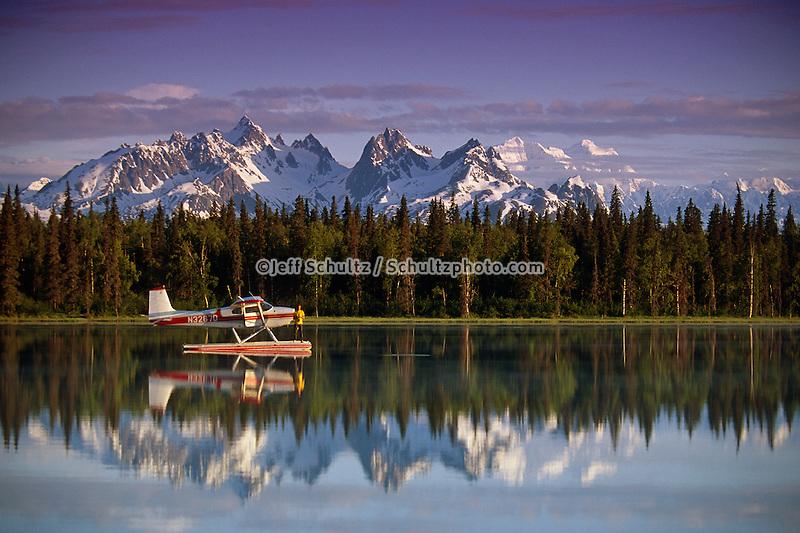 Man On Floatplane Ak Range Lake Spin Fishing Summer Ak Southcentral