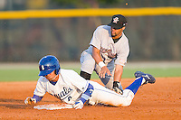 Derek Rodriguez #4 of the Burlington Royals steals second base as Ricardo Garcia #13 of the Greeneville Astros tries to apply a tag at Burlington Athletic Stadium June22, 2010, in Burlington, North Carolina.  Photo by Brian Westerholt / Four Seam Images