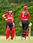 Charlotte Chan Sau Ha (l) of Hong Kong talks to teammate Marina Lamplough during their ICC 2016 Women's World Cup Asia Qualifier match between China and Hong Kong on 10 October 2016 at the Hong Kong Cricket Club in Hong Kong, China. Photo by Victor Fraile / Power Sport Images