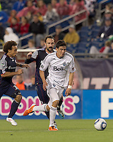 Vancouver Whitecaps FC forward Omar Salgado (17) on the attack as New England Revolution defender Kevin Alston (30) and New England Revolution defender Ryan Cochrane (45) close. In a Major League Soccer (MLS) match, the New England Revolution defeated the Vancouver Whitecaps FC, 1-0, at Gillette Stadium on May14, 2011.