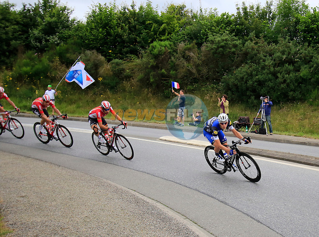 The peloton pass through Segre during Stage 3 of the 2016 Tour de France, running 223.5km from Granville to Angers, France . 4th July 2016.<br /> Picture: Eoin Clarke | Newsfile<br /> <br /> <br /> All photos usage must carry mandatory copyright credit (&copy; Newsfile | Eoin Clarke)