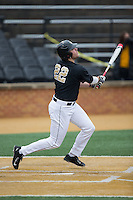 Will Craig (22) of the Wake Forest Demon Deacons follows through on his swing against the Towson Tigers at Wake Forest Baseball Park on March 1, 2015 in Winston-Salem, North Carolina.  The Demon Deacons defeated the Tigers 15-8.  (Brian Westerholt/Four Seam Images)