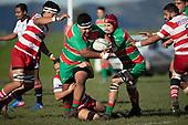 Galipoli Misileki tries to break free from the Andrew West tackle. Counties Manukau Premier Club Rugby game between Karaka and Waiuku, played at Karaka Sports Park on Saturday June 9th 2018. Karaka won the game 22 - 18 after trailing 5 - 13 at halftime.  Photo by Richard Spranger.