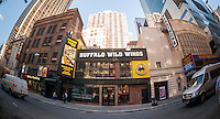 A Times Square branch of the Buffalo Wild Wings restaurant chain in New York on Friday, November 14, 2014. The chain recently saw a 6% rise in quarterly sales while its casual dining competitors, such as the Olive Garden and Red Lobster,  are struggling to attract customers. (© Richard B. Levine)