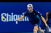 27th October 2019; St. Jakobshalle, Basel, Switzerland; ATP World Tour Tennis, Swiss Indoors Final; Alex de Minaur (AUS) hits a forehand in the match against Roger Federer (SUI) - Editorial Use