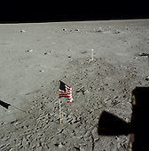 The Moon - (FILE) -- View of lunar surface after Extra Vehicular Activity (EVA) completion on Monday, July 21,1969 with the United States flag and TV camera. Note the difference between the darker, heavily disturbed soil around the camera, and the undisturbed light soil where Armstrong and Aldrin did not set foot..Credit: NASA via CNP.