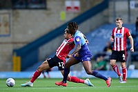 Lincoln City's Tyler Walker shields the ball from  Wycombe Wanderers' Anthony Stewart<br /> <br /> Photographer Andrew Vaughan/CameraSport<br /> <br /> The EFL Sky Bet League One - Wycombe Wanderers v Lincoln City - Saturday 7th September 2019 - Adams Park - Wycombe<br /> <br /> World Copyright © 2019 CameraSport. All rights reserved. 43 Linden Ave. Countesthorpe. Leicester. England. LE8 5PG - Tel: +44 (0) 116 277 4147 - admin@camerasport.com - www.camerasport.com