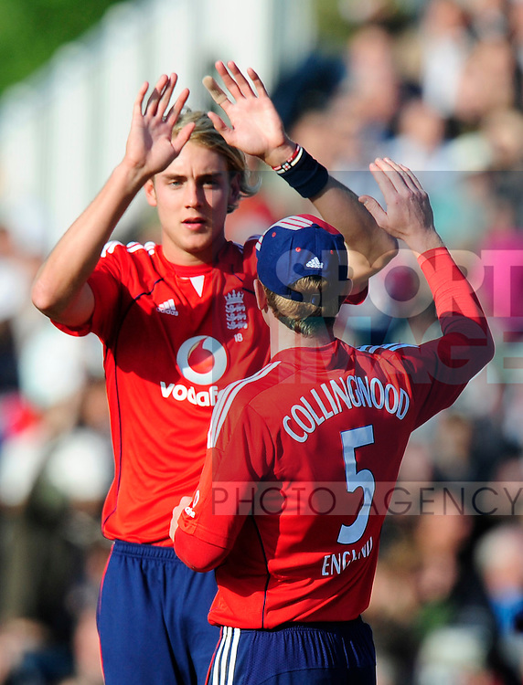 England bowler Stuart Broad celebrates a wicket with Paul Collingwood