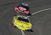 Oct. 10, 2009; Fontana, CA, USA; NASCAR Nationwide Series driver Brian Vickers leads Kevin Harvick during the Copart 300 at Auto Club Speedway. Mandatory Credit: Mark J. Rebilas-