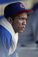 Juan Cruz of the Chicago Cubs sits in the dugout during a 2002 MLB season game against the Los Angeles Dodgers at Dodger Stadium, in Los Angeles, California. (Larry Goren/Four Seam Images)