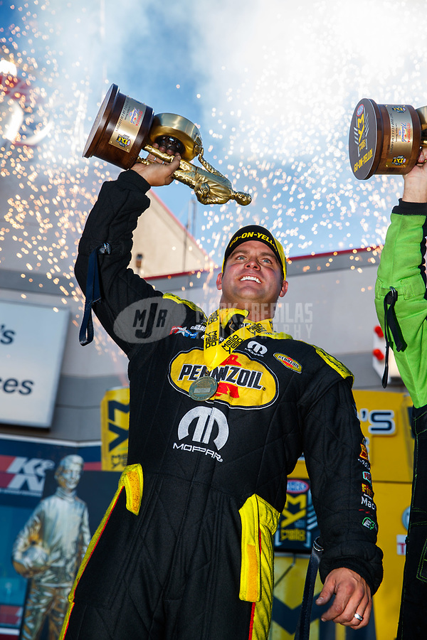 Oct 29, 2017; Las Vegas, NV, USA; NHRA funny car driver Matt Hagan celebrates after winning the Toyota National at The Strip at Las Vegas Motor Speedway. Mandatory Credit: Mark J. Rebilas-USA TODAY Sports