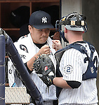(L-R) Masahiro Tanaka, Brian McCann (Yankees),<br /> SEPTEMBER 21, 2014 - MLB :<br /> Masahiro Tanaka of the New York Yankees bumps fists with teammate Brian McCann in the dugout after being pulled in the sixth inning during the Major League Baseball game against the Toronto Blue Jays at Yankee Stadium in Bronx, New York, United States. (Photo by AFLO)