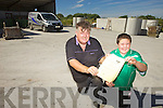 INSPECTIONS: Ballyduff man Noel Power, pictured with his son Jason, is the first in the county registered to inspect concrete septic tanks.