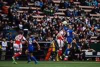 Seattle, WA - Thursday, May 26, 2016: Seattle Reign FC midfielder Havana Solaun (19) goes up for a header with Emma Mitchell (3) of Arsenal Ladies FC. The Seattle Reign FC of the National Women's Soccer League (NWSL) and the Arsenal Ladies FC of the Women's Super League (FA WSL) played to a 1-1 tie during an international friendly at Memorial Stadium.