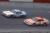 HAMPTON, GA - NOV 3:  Terry Labonte, #44 Chevrolet, and Darrell Waltrip, #11 Chevrolet, race through a turn during the Atlanta Journal 500 NASCAR Winston Cup race at Atlanta Motor Speedway, November 3, 1985. (Photo by Brian Cleary/www.bcpix.com)