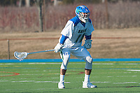 Steven Russell,'15, stands guard as the Salve Regina men's lacrosse team dominates Anna Maria at Gaudet Field in Middletown.