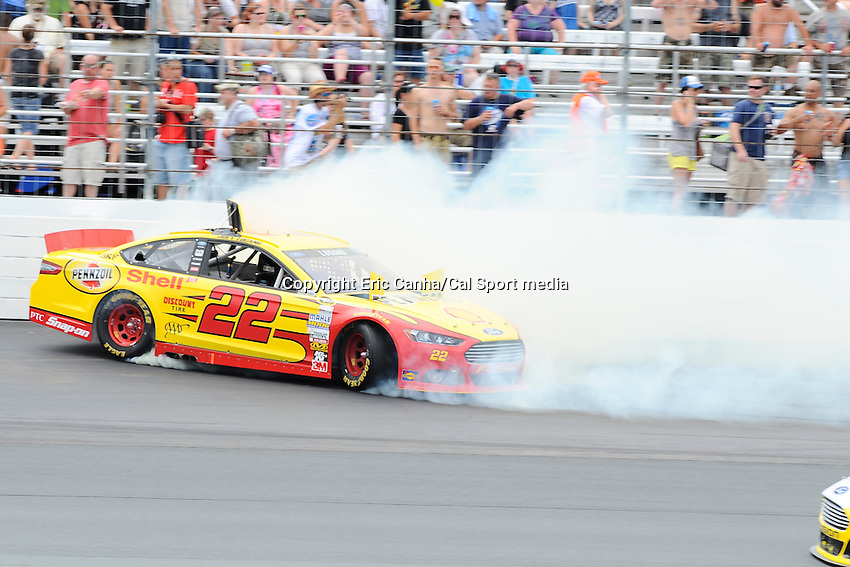 July 14, 2013 - Loudon, New Hampshire U.S. - Sprint Cup Series driver Joey Logano (22) spins out in turn 1 during the NASCAR Sprint Cup Series Camping World RV Sales 301 held at the New Hampshire Motor Speedway in Loudon, New Hampshire.   Eric Canha/CSM