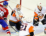 26 October 2009: New York Islanders' goaltender Martin Biron makes a third period save against the Montreal Canadiens at the Bell Centre in Montreal, Quebec, Canada. The Canadiens defeated the Islanders 3-2 in sudden death overtime for their 4th consecutive win. Mandatory Credit: Ed Wolfstein Photo