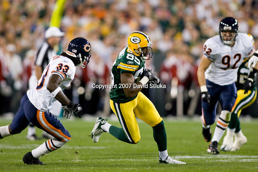 Wide receiver Greg Jennings #85 of the Green Bay Packers gains yardage after a reception during an NFL football game against the Chicago Bears at Lambeau Field on October 7, 2007 in Green Bay, Wisconsin. The Bears beat the Packers 27-20. (Photo by David Stluka)