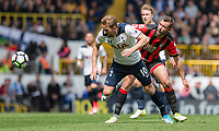 Harry Kane of Tottenham Hotspur gets away from Steve Cook of Bournemouth during the Premier League match between Tottenham Hotspur and Bournemouth at White Hart Lane, London, England on 15 April 2017. Photo by Mark  Hawkins / PRiME Media Images.
