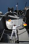 "A Signalman signals ""Go San Pedro"" during the final voyage of the battleship USS Iowa from Berth 51 to its new home at Berth 87 in San Pedro, Los Angeles, CA where it opens as a museum ship in July 2012."