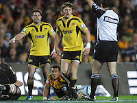 Cory Jane (left), Beauden Barrett and Tim Nanai-Williams (on ground) react to a decision by referee Jonathon White during the Super 15 rugby match between the Chiefs and Hurricanes at Waikato Stadium, Hamilton, New Zealand on Saturday, 28 April 2011. Photo: Dave Lintott / lintottphoto.co.nz