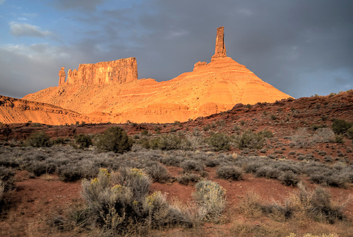 Castle Rocks is illuminated during sunset in the Castle Valley near Moab, Utah