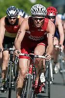 26th MAR 2006 - MOOLOOLABA, AUSTRALIA - Paul Tichelaar (CAN) leads a bike pack at the Mooloolaba round of the ITU World Cup. (PHOTO (C) NIGEL FARROW)