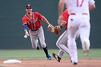 Shortstop Braden Shewmake (39), an Atlanta Braves' First-Round pick (21st overall) out of Texas A&M in the 2019 MLB Draft, now with the Rome Braves, shovels the ball to second baseman Greg Cullen (18) to make a putout at second in a game against the Greenville Drive on Thursday, June 27, 2019, at Fluor Field at the West End in Greenville, South Carolina. Rome won, 4-3. (Tom Priddy/Four Seam Images)