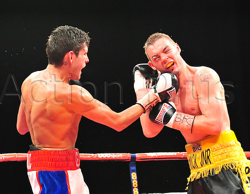 21.05.2014.  Leeds, England. Josh Wale takes a strong right hook from Gavin McDonnell during their fight at The First Direct Arena.