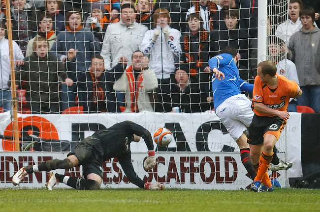 Warren Feeney beats the clumsy challenge of Lee McCulloch to head in Dundee Utd's second goal past Allan McGregor