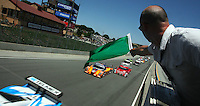 May 17, 2009:  The green flag waves to start the Verizon Festival of Speed Grand-Am Rolex Series race at Mazda Raceway at Laguna Seca  in Salinas, CA. (Photo by Brian Cleary/www.bcpix.com)