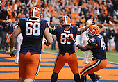 Syracuse Orange tight end Josh Parris (89) celebrates with teammates Nick Robinson (68) and Jerome Smith (45) after scoring the game winning touchdown against the Boston College Eagles during a game at the Carrier Dome on November 30, 2013 in Syracuse, New York.  Syracuse defeated Boston College 34-31.  (Copyright Mike Janes Photography)
