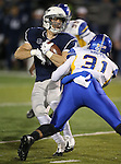 Nevada's Kendall Brock spins away from San Jose State defender Keith Smith in an NCAA college football game in Reno, Nev., on Saturday, Nov. 16, 2013. (AP Photo/Cathleen Allison)