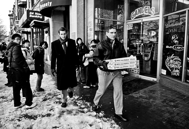 "After his morning flight back to Nevada was cancelled by a snow storm, Joe, accompanied by legislative aide Ryan McBride, walks down Pennsylvania Ave., on Capitol Hill to deliver pizza from ""We, The Pizza"" to his staff in the Cannon House Office Building. (Photo By Bill Clark/Roll Call)"