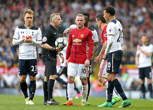 May 14th 2017,White Hart Lane, Tottenham, London, England; EPL Premier League football, Tottenham Hotspur versus Manchester United; Referee Jon Moss explaining his decision to award Spurs a free kick to Dele Alli of Tottenham Hotspur, Wayne Rooney of Manchester United, Ander Herrera of Manchester United, Christian Eriksen of Tottenham Hotspur, Victor Wanyama of Tottenham Hotspur
