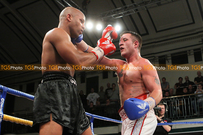 Shane McPhilbin (white shorts) defeats Leon Williams in a Cruiserweight boxing contest for the British Title at York Hall, Bethnal Green, promoted by Queensberry Promotions - 13/01/12 - MANDATORY CREDIT: Gavin Ellis/TGSPHOTO - Self billing applies where appropriate - 0845 094 6026 - contact@tgsphoto.co.uk - NO UNPAID USE.